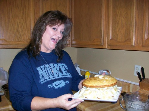 Mom helping me with my Tres Leches cake