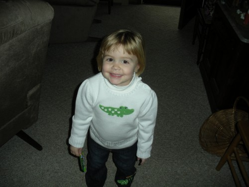 Sporting an Alligator shirt from her Uncle Eddeaux